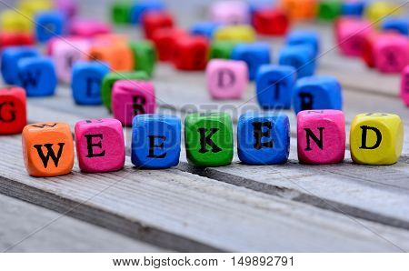 Weekend word on gray  wooden table closeup