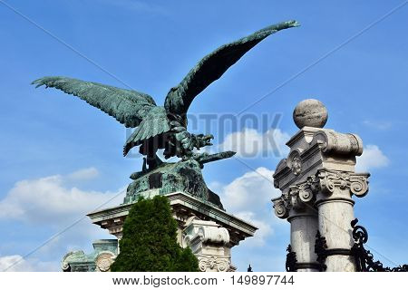 The mythological bird of prey Turul the national symbol of Hungary. Bronze statue at the entrance of Budapest royal palace made by artist Gyula Donath in 1905