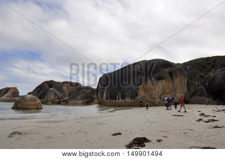 DENMARK,WA,AUSTRALIA-OCTOBER 2,2014: Tourists at the secluded Elephant Cove beach on the Great Southern Ocean coastline with enormous granite rock formations in Denmark, Western Australia.