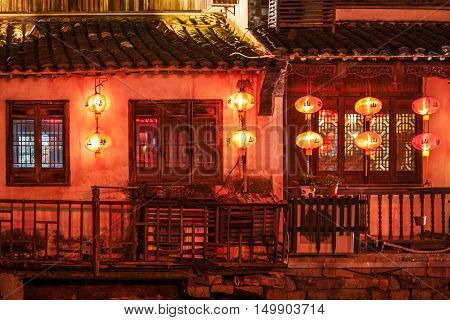 Suzhou traditional houses at night with red chinese lanterns China