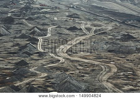 Open pit mining of coal with waste pile