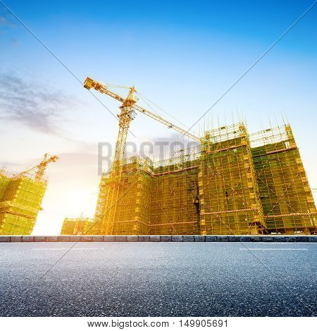 Construction site of modern urban construction site and crane.