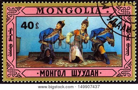 MONGOLIA - CIRCA 1987: A stamp printed in Mongolia shows traditional dance, circa 1987.