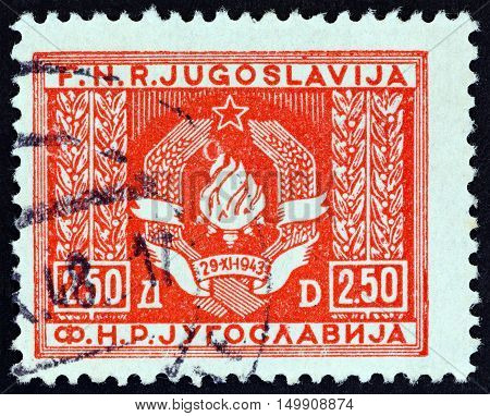 YUGOSLAVIA - CIRCA 1946: A stamp printed in Yugoslavia shows Coat of Arms of Yugoslavia, circa 1946.