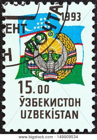 UZBEKISTAN - CIRCA 1993: A stamp printed in Uzbekistan shows Coat of Arms and Flag, circa 1993.