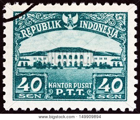 INDONESIA - CIRCA 1953: A stamp printed in Indonesia shows Bandung Post Office, circa 1953.
