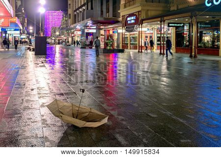 Adelaide Australia - August 11 2015: Broken umbrella after the rain lost by someone at Adelaide's famous Rundle Mall at night time
