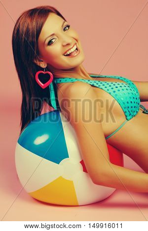 Laughing bikini beach ball woman