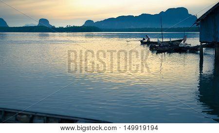 Phang-Nga Thailand - August 9 2014: Thai fisherman in long tail fishing boat at Samchong fishing village on sunrise in Phang-NgaThailand.