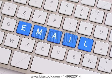 Email in blue on a white keyboard