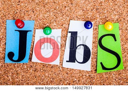 The Word Jobs In Cut Out Magazine Letters Pinned To A Cork Notice Board..