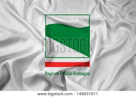 Waving Flag of Emilia-Romagna Italy, with beautiful satin background. 3D illustration