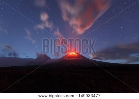Beautiful volcanic landscape of Kamchatka: night view of eruption active Klyuchevskaya Sopka. Eurasia Russia Far East Kamchatka Peninsula Klyuchevskaya Group of Volcanoes.