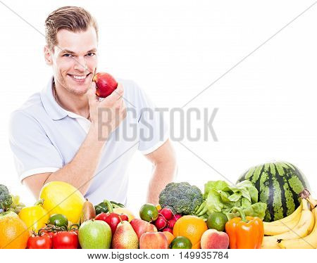 Cheerful Beautiful Man Eating Apple, Isolated Over White Background..