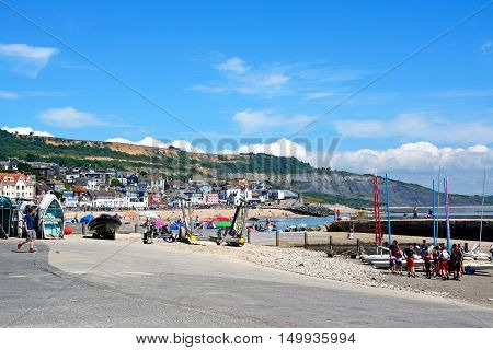 LYME REGIS, UNITED KINGDOM - JULY 18, 2016 - View of the coastline and town from the harbour area Lyme Regis Dorset England UK Western Europe, July 18, 2016.