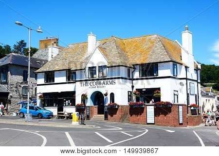 LYME REGIS, UNITED KINGDOM - JULY 18, 2016 - Front view of The Cobb Arms public house Lyme Regis Dorset England UK Western Europe, July 18, 2016.