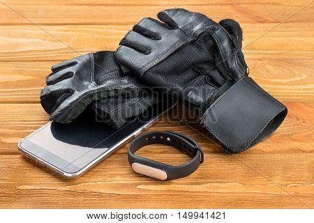 Fitness Bracelet, Gloves And Smartphone