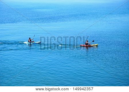 LYME REGIS, UNITED KINGDOM - JULY 18, 2016 - Holidaymakers canoeing in the sea Lyme Regis Dorset England UK Western Europe, July 18, 2016.