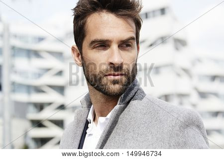 Handsome Businessman looking away close up on location
