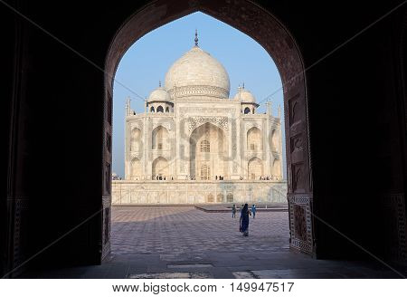 AGRA INDIA - February 21: The people visit Taj Mahal Agra India on February 21 2015. The Taj Mahal is a mausoleum located in Agra India and is one of the most recognizable structures in the world