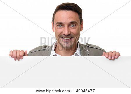 Cheerful Man Standing Behind A Blank Billboard