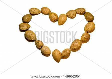 A hearted shap almonds in a white background