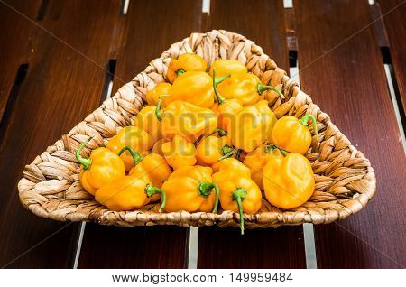 Yellow Orange Ripe Habanero Hot Chili Peppers On A Wooden Plate