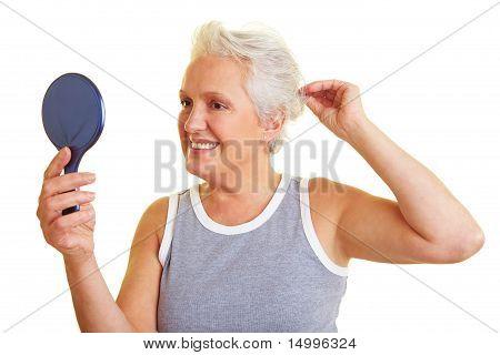 Senior Woman With Hand Mirror