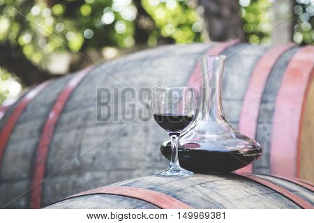 Bottle of wine with wine glass on the runlet. Red wine.