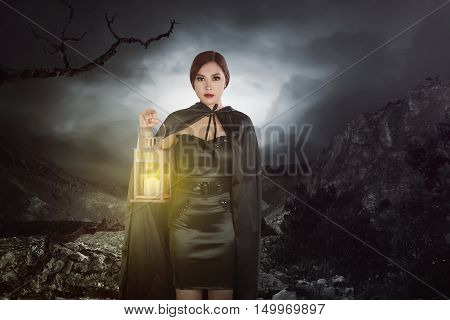 Asian Witch Woman With A Lantern