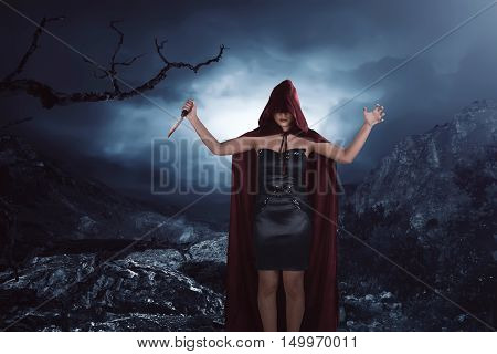 Scary Portrait Of An Asian Witch Woman Covering His Face Holding A Sharp Knife