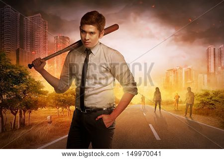 Young Man With A Wooden Baseball Bat Standing In Front Of Some Zombies