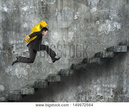 Man Carrying Golden Dollar Sign Running On Old Concrete Stairs