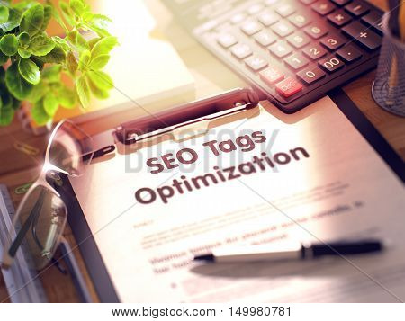 SEO Tags Optimization. Business Concept on Clipboard. Composition with Clipboard, Calculator, Glasses, Green Flower and Office Supplies on Office Desk. 3d Rendering. Blurred Illustration.