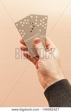Two Gray Plastic Door Key Cards In Hand