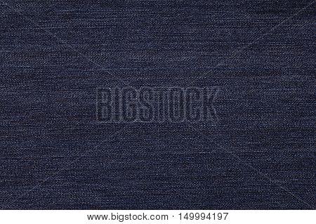 Dark blue denim texture. Fabric texture of the jeans. Closeup