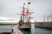 Christopher Columbus flagship Santa Maria historical ship replica at Funchal harbor. Madeira island, Portugal. poster