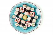 Sushi with vasabi on the blue plate. poster