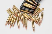 Ammunition in magazine .223/556 isolated a on white surface poster