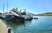 sunk boats at the port of Salamis Saronic gulf Greece poster