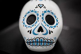 Dia de muertos sugar skull decorative on dark background