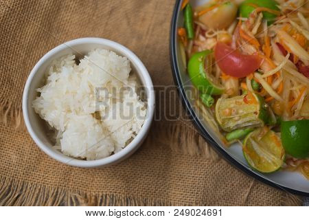 Close Up Of Sticky Rice Served On White Bowl Eating With Thai Local Food