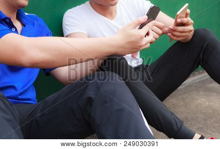 Young Athlete Men Working On Smartphone While Resting In Sport Club. Mobile Office, Freelance, Lifes