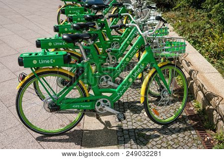 Berlin, Germany - July 2018: E-bikes, Many  Electric Bicycles Of Public Bike Sharing Company Limebik