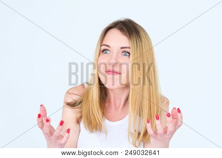 emotion face. angry mad cross enraged woman. young beautiful blond girl portrait on white background. poster