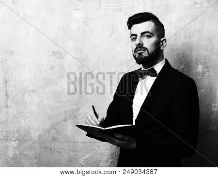 Bearded Employer With Cunning Face Expression And Neat Stylish Outfit Writes Notes In His Planner, C