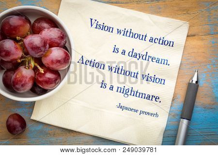 Vision without action is a daydream. Action without vision is a nightmare. Japanese proverb. Handwriting on a napkin with grapes.