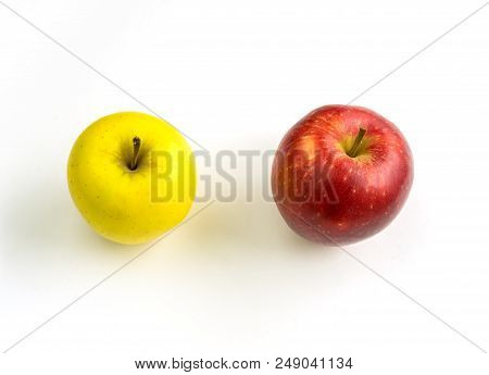 Close-up Of Two Colorful Apples On A White Background.  View From Above To A Yellow And Red Apple On