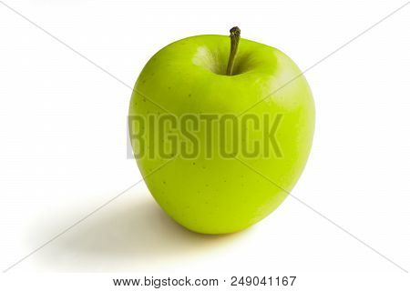 Close-up Of A Green Apple On A White Background.  View To A Apple On A Clean Background. Vegetarian