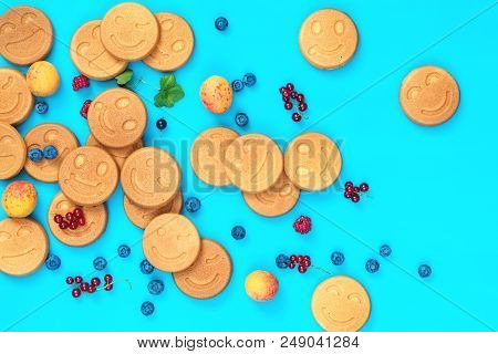 Delicious Mini Smile Pancakes With Berries On Blue Surface